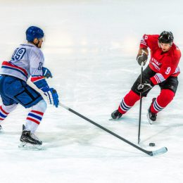 Two ice hockey players  in action, high angle view.